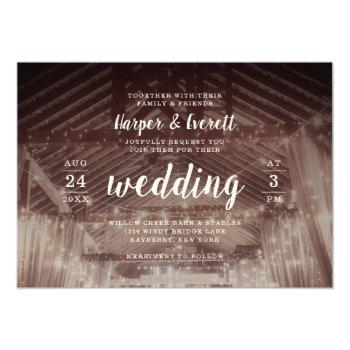 barn rafters with string lights rustic wedding invitation