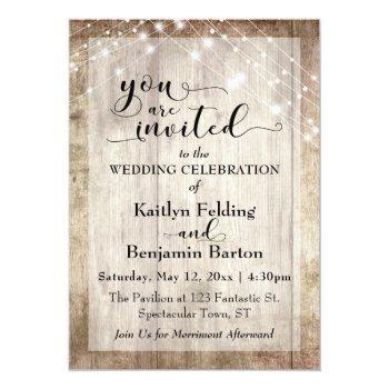 rustic light brown wood w/ light strings, wedding invitation