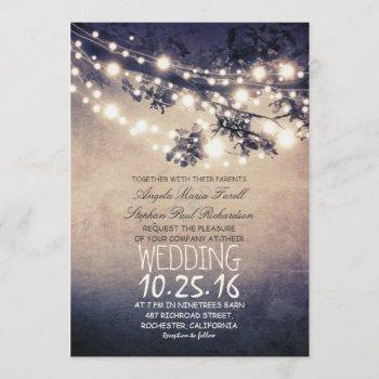 rustic tree branches & string lights wedding invitation