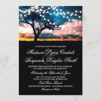 string of lights tree at sunset wedding invitation