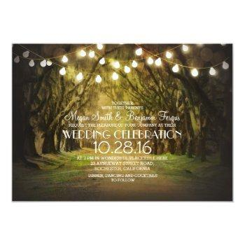string of lights trees path rustic wedding invites