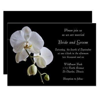 white orchid flowers on black wedding invitation