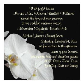 white orchid on black invitation